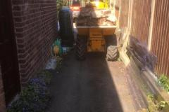 Small access , so a very narrow dumper solved this problem for removing the old concrete and soil